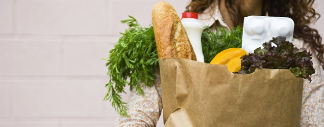A woman holding groceries. Image supplied.