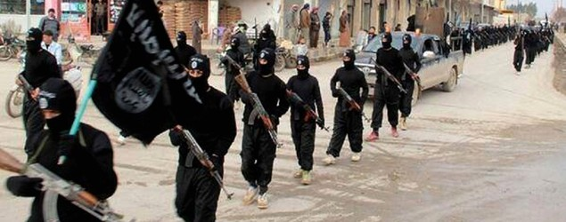 Islamic State militants march, AP