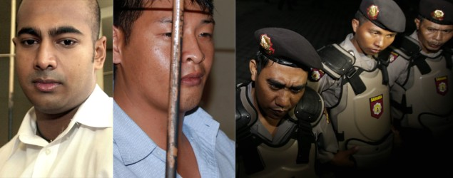The Bali Nine duo and Indonesian police waiting to transport them. Photo: AAP