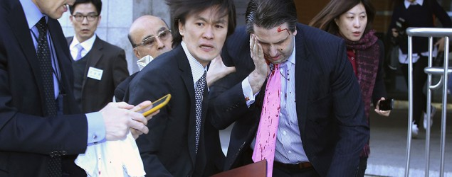 U.S. ambassador to South Korea Mark Lippert leaves after he was slashed in the face at a public forum in central Seoul, March 5, 2015. (Yonhap/Reuters)