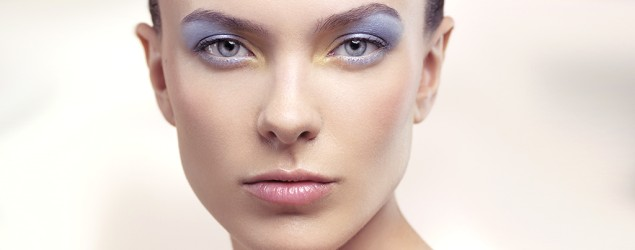 A young woman with soft pastel blue makeup (Corbis)