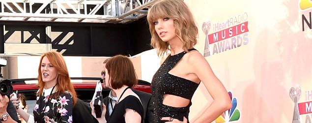 Taylor Swift hits the red carpet at the iHeartRadio Music Awards. (Jason Merritt/Getty Images)
