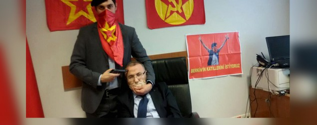 Armed leftists take prosecutor hostage. Photo: Reuters