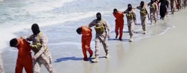 Islamic State militants lead what are said to be Ethiopian Christians along a beach. (Reuters)