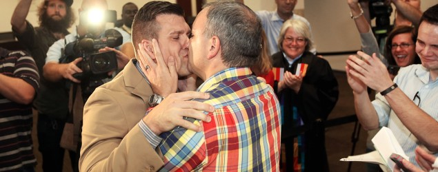 Chad Briggs, left, and Chris Creech kiss after exchanging wedding vows at the Wake County Courthouse in Raleigh, N.C., on Oct. 10, 2014. (Getty Images)