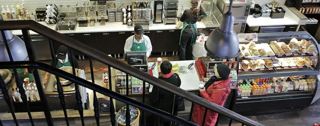A Starbucks employee takes orders from customers in Washington, D.C. (Drew Angerer/Getty Images)