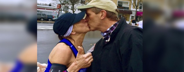 Barbara Tatge, left, kisses an unknown spectator as she ran in the Boston Marathon. Photo: Paige Tatge via AP