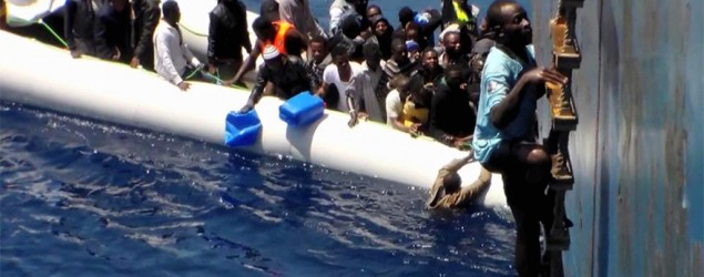 Video shows migrants scrambling to safety . Photo: AP