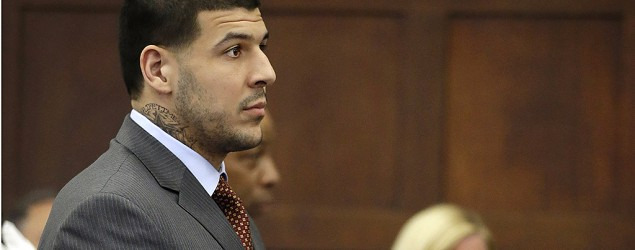Aaron Hernandez sports new neck tattoo as he pleads not guilty to witness intimidation. (AP)
