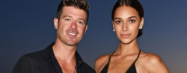 Robin Thicke steps out with new girlfriend. (AP)