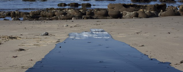 Oil flows on a beach near Santa Barbara, Calif., after an oil spill. (Getty Images)