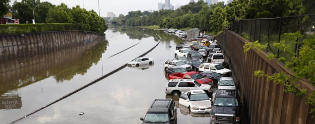 Motorists are stranded along I-45 along North Main in Houston after storms flooded the area on May 26, 2015. (AP/Cody Duty/Houston Chronicle)