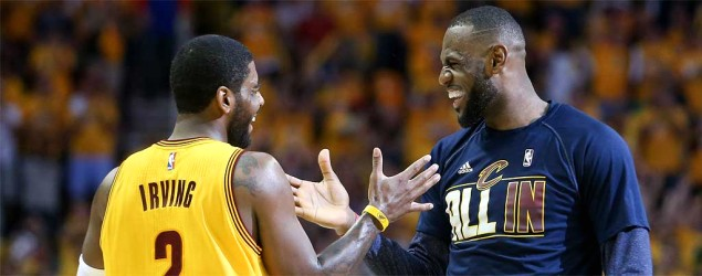 LeBron James and Kyrie Irving of the Cleveland Cavaliers slap hands during Game 4 of the NBA Eastern Conference Finals against the Atlanta Hawks. (Ron Schwane/AP)