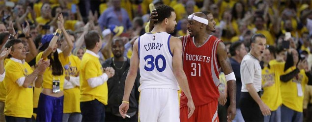 Golden State Warriors guard Stephen Curry is congratulated by Houston Rockets guard Jason Terry after Game 5. (Ben Margot/AP)