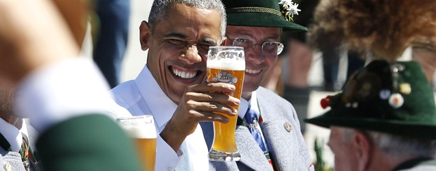 President Barack Obama toasts with a beer prior to the G-7 summit in Germany. (Markus Schreiber/AP)