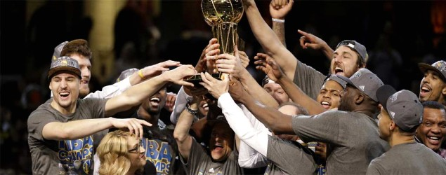 The Golden State Warriors celebrate after winning the NBA Finals. (Tony Dejak/AP)