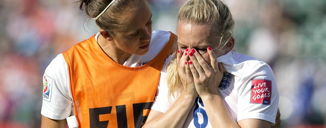 England's Josanne Potter consoles Laura Bassett after the team's loss to Japan during the Women's World Cup semifinal. (Jason Franson/The Canadian Press/AP)