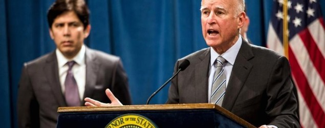 """California Gov. Jerry Brown signs a bill that removes """"lynching"""" language from state law. (Reuters)"""