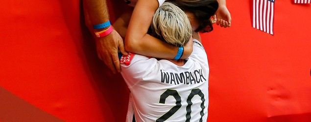Abby Wambach of the United States celebrates with wife, Sarah Huffman, after the U.S. won the World Cup. (Kevin C. Cox/Getty Images)