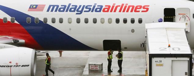 A visitor looks at Malaysia Airlines aircraft at the Kuala Lumpur International Airport in Sepang, Malaysia, Tuesday, May 27, 2014. (Vincent Thian/AP)