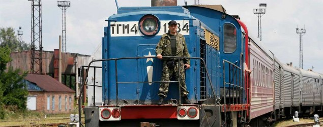 A guard stands on a train carrying the remains of victims of Malaysia Airlines MH17 after it arrived in the city of Kharkiv, eastern Ukraine. (Reuters)
