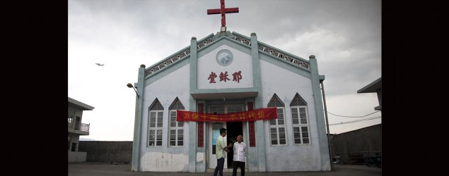 Pastor Tao Chongyin, left, speaks with church member Fan Liang'an in front of the Wuxi Christian Church in Longwan, Wenzhou in China's Zhejiang province. (AP/Didi Tang)