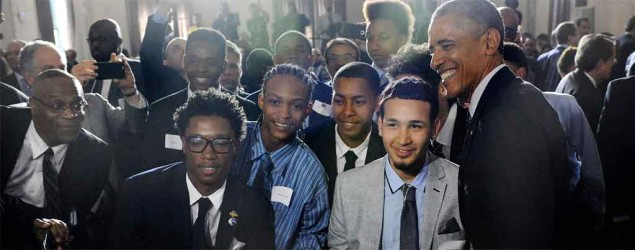 Students pose with President Obama at the launch of My Brother's Keeper alliance at Lehman College in the Bronx, N.Y., in May. (Susan Watts/The Daily News via AP)