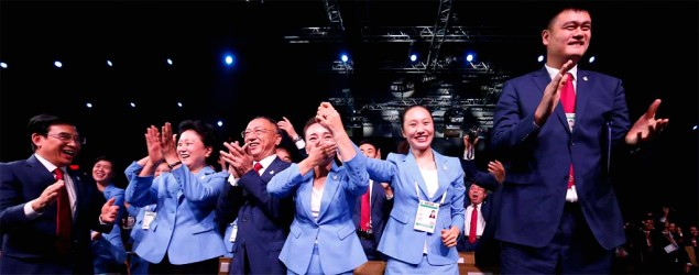 Members of the Chinese delegation react after Beijing was selected to host the 2022 Olympic Winter Games. (Vincent Thian/AP)