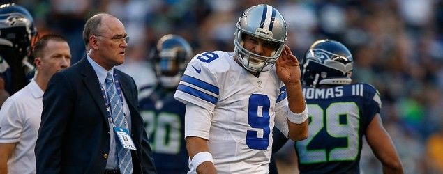 Tony Romo leaves NFL preseason game after hit. (Getty Images)