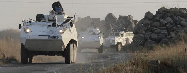 U.N. peacekeepers escape from Syrian rebels. (Reuters)