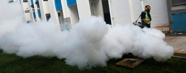 A worker fogs the drains in the common areas of a public housing estate at an area where locally transmitted Zika cases were discovered in Singapore August 31, 2016. REUTERS/Edgar Su