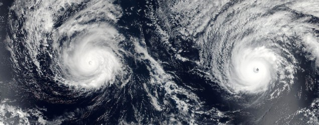 Hurricanes Lester (R) and Madeline (L) in the Pacific Ocean in a NASA satellite image. (AFP)