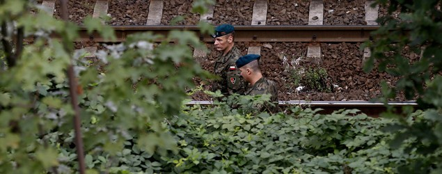 Soldiers inspect a site in an area where a Nazi train is believed to be, near Walbrzych, Poland. (Reuters)