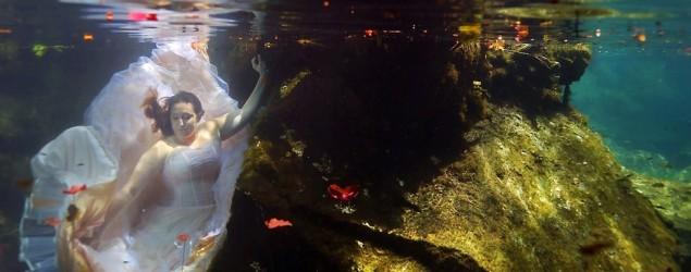 Heartbroken bride's striking underwater photos