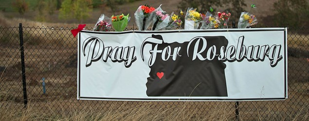 A sign sits along the road to Umpqua Community College in Roseburg, Ore. (Scott Olson/Getty Images)