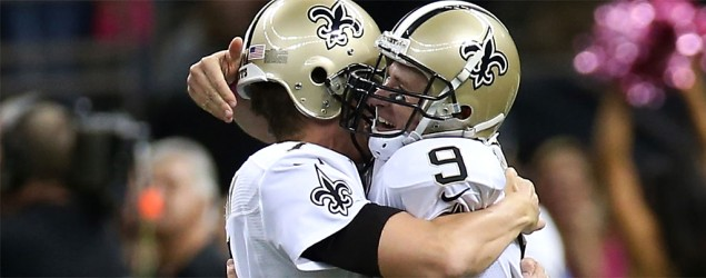 Saint s QB Drew Brees, right, celebrates after throwing his 400th touchdown pass. (Chris Graythen/Getty Images)