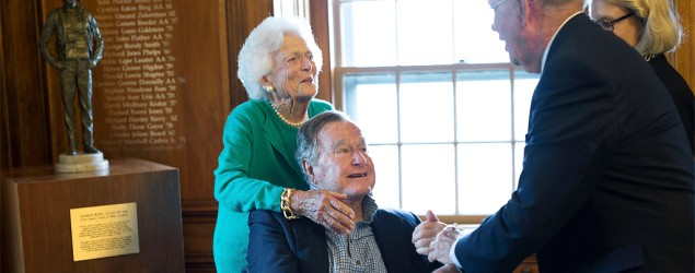 Former President George H.W. Bush, with his wife Barbara, speaks with a former classmate  during a visit to Phillips Academy in Andover, Mass. (AP)