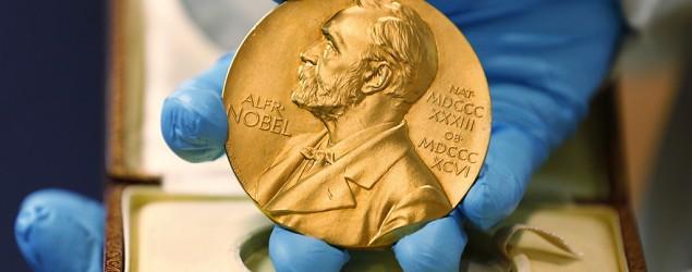 A national libray employee shows the gold Nobel Prize medal awarded to the late novelist Gabriel Garcia Marquez. (Fernando Vergara/AP)