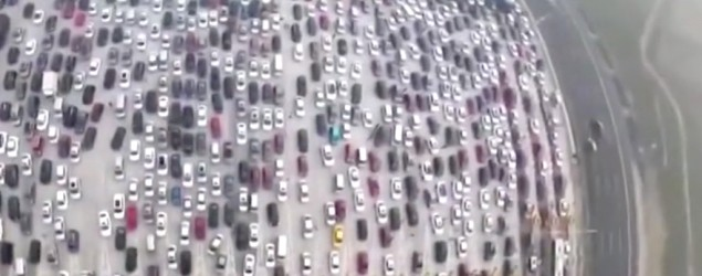 Footage shows several hundreds of thousands of drivers slowly making their way home in China. (WSJ video)