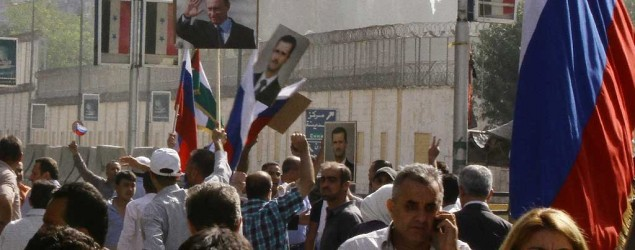 Hundreds of people gather near the Russian Embassy in Damascus, Syria. (Louai Beshara/AFP)