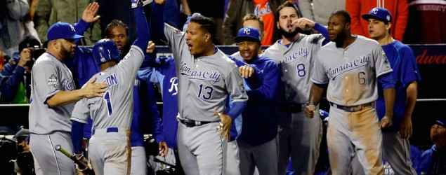 Kansas City Royals' Jarrod Dyson is congratulated after scoring in the 12th inning of Game 5 of the World Series. (AP)