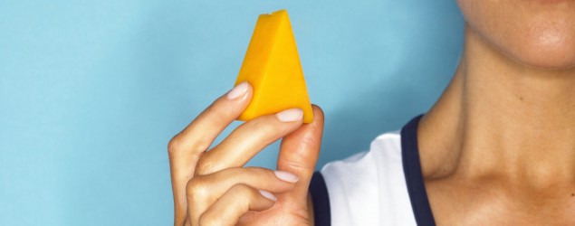 Woman with cheese. Photo: Getty