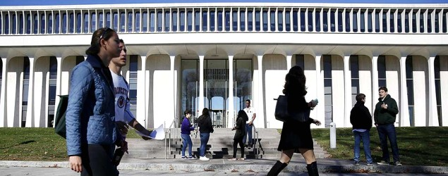 People walk past Princeton University's Woodrow Wilson School of Public and International Affairs in Princeton, N.J. (Dominick Reuter/Reuters)