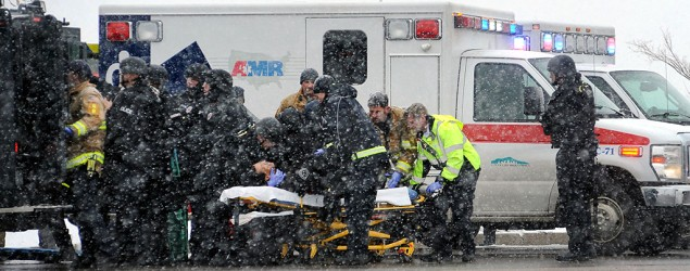 Emergency personnel transport an officer to an ambulance after reports of a shooting near the Planned Parenthood clinic in Colorado Springs, Colo. (Daniel Owen/The Gazette via AP)