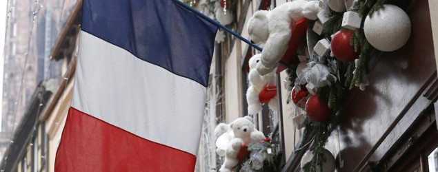 French flag's new meaning as nation honors victims. (Reuters)