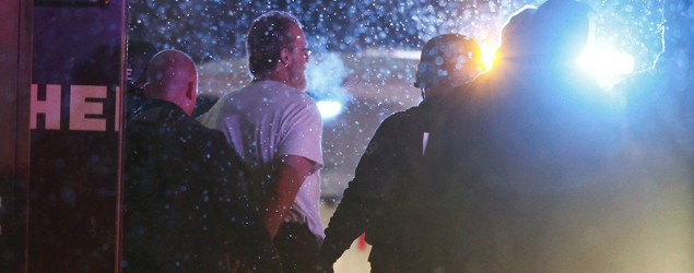 A suspect is taken into custody outside a Planned Parenthood center in Colorado Springs, Colo. (Isaiah J. Downing/Reuters)