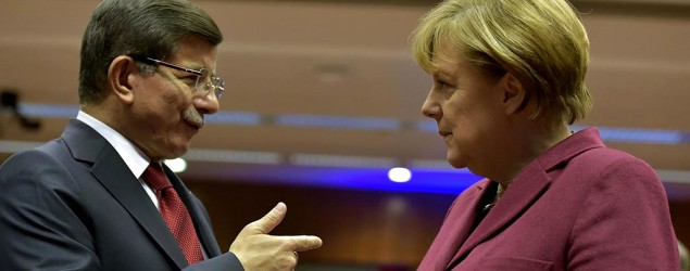 Turkish Prime Minister Ahmet Davutoglu, left, talks with German Chancellor Angela Merkel. (Reuters)
