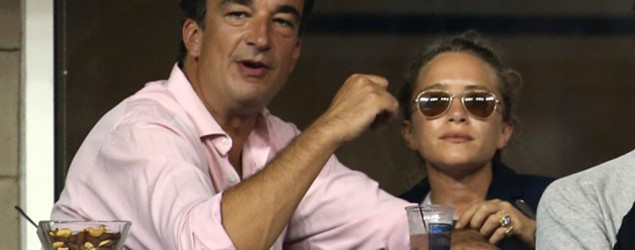 Mary-Kate Olsen and her boyfriend Olivier Sarkozy, brother of former French President Nicolas Sarkozy attend Day 8 of the 2014 US Open at USTA Billie Jean King National Tennis Center on September 1, 2014 in the Flushing neighborhood of the Queens borough of New York City. (Photo by Jean Catuffe/GC Images)