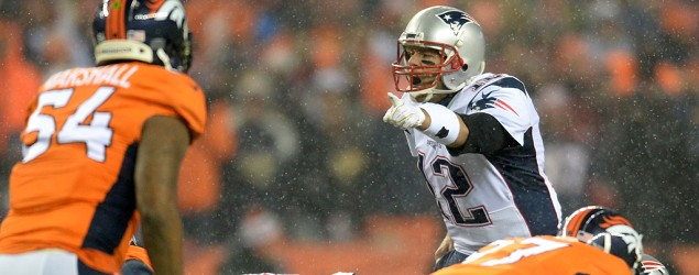 Tom Brady leads the Patriots against the Broncos. (Reuters)