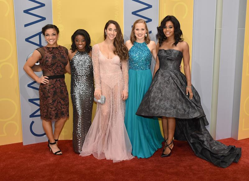 Olympic gymnasts Laurie Hernandez, left, Simone Biles, Aly Raisman, Madison Kocian and Gabby Douglas at the 50th annual CMA Awards in Nashville on Nov. 2, 2016, in Nashville. (John Shearer via Getty Images)